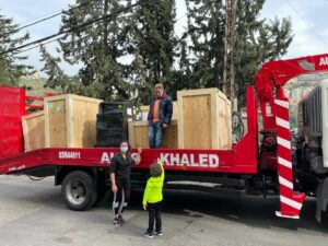 Image: Delivery of the medical equipment in Lebanon. Left is Aida Adra, founder and member of Land for Hope with her husband and child.